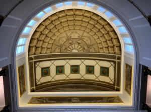 The ornate domed ceiling above the stairwell